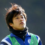 DORTMUND, GERMANY - FEBRUARY 28:  Atsuto Uchida of Schalke looks on prior to the Bundesliga match between Borussia Dortmund and FC Schalke 04 at Signal Iduna Park on February 28, 2015 in Dortmund, Germany.  (Photo by Martin Rose/Bongarts/Getty Images)