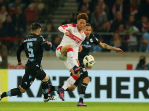 STUTTGART, GERMANY - OCTOBER 21:  Takuma Asano (C) of Stuttgart fights for the ball with Fanol Perdedaj (L) and Daylon Claasen (R) of Muenchen during the Second Bundesliga match between VfB Stuttgart and TSV 1860 Muenchen at Mercedes-Benz Arena on October 21, 2016 in Stuttgart, Germany.  (Photo by Thomas Niedermueller/Bongarts/Getty Images)