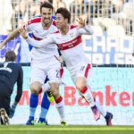 KARLSRUHE, GERMANY - OCTOBER 30: Takuma Asano of Stuttgart celebrates the first goal for his team with Emiliano Insua of Stuttgart and Marcin Kaminski of Stuttgart during the Second Bundesliga match between Karlsruher SC and VfB Stuttgart at Wildparkstadion on October 30, 2016 in Karlsruhe, Germany. (Photo by Alexander Scheuber/Bongarts/Getty Images)