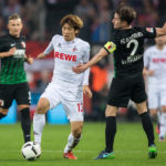 COLOGNE, GERMANY - NOVEMBER 26: Yuya Osako of Koeln (M) and Paul Verhaegh (R) of Augsburg in action during the Bundesliga match between 1. FC Koeln and FC Augsburg at RheinEnergieStadion on November 26, 2016 in Cologne, Germany. (Photo by Lukas Schulze/Bongarts/Getty Images)