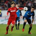 SINSHEIM, GERMANY - DECEMBER 03:  Yuya Osako of FC Koeln is challenged by Benjamin Huebner of TSG 1899 Hoffenheim during the Bundesliga match between TSG 1899 Hoffenheim and 1. FC Koeln at Wirsol Rhein-Neckar-Arena on December 3, 2016 in Sinsheim, Germany.  (Photo by Adam Pretty/Bongarts/Getty Images)