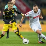 COLOGNE, GERMANY - DECEMBER 10: Marco Reus (L) of Dortmund and Marco Hoeger (R) of Koeln in action during the Bundesliga match between 1. FC Koeln and Borussia Dortmund at RheinEnergieStadion on December 10, 2016 in Cologne, Germany. (Photo by Lukas Schulze/Bongarts/Getty Images)