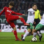 BREMEN, GERMANY - DECEMBER 17:  Philipp Bargfrede (C) of Bremen and Yuya Osako (L) Koeln compete for the ball during the Bundesliga match between Werder Bremen and 1. FC Koeln at Weserstadion on December 17, 2016 in Bremen, Germany.  (Photo by Oliver Hardt/Bongarts/Getty Images)