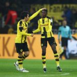DORTMUND, GERMANY - DECEMBER 20: Ousmane Dembele (R) of Borussia Dortmund celebrates scoring his team's opening goal with Shinji Kagawa during the Bundesliga match between Borussia Dortmund and FC Augsburg at Signal Iduna Park on December 20, 2016 in Dortmund, Germany.  (Photo by Dean Mouhtaropoulos/Bongarts/Getty Images)