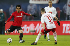 LEIPZIG, GERMANY - JANUARY 21:  Makoto Hasebe of Eintracht Frankfurt is challenged by Diego Demme of RB Leipzig during the Bundesliga match between RB Leipzig and Eintracht Frankfurt at Red Bull Arena on January 21, 2017 in Leipzig, Germany.  (Photo by Boris Streubel/Bongarts/Getty Images)