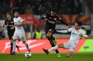 AUGSBURG, GERMANY - FEBRUARY 17:  Karim Bellarabi of Leverkusen is challenged by Takashi Usami of Augsburg during the Bundesliga match between FC Augsburg and Bayer 04 Leverkusen at WWK Arena on February 17, 2017 in Augsburg, Germany.  (Photo by Matthias Hangst/Bongarts/Getty Images)