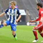 BERLIN, GERMANY - FEBRUARY 18: Genki Haraguchi of Hertha BSC and Juan Bernat of FC Bayern Muenchen during the game between Hertha BSC and FC Bayern Muenchen on February 18, 2017 in Berlin, Germany. (Photo by City-Press via Getty Images)