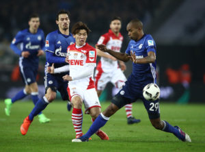 COLOGNE, GERMANY - FEBRUARY 19:  Yuya Osako of Koeln is challenged by Naldo of Schalke during the Bundesliga match between 1. FC Koeln and FC Schalke 04 at RheinEnergieStadion on February 19, 2017 in Cologne, Germany.  (Photo by Alex Grimm/Bongarts/Getty Images)