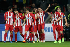 LEVERKUSEN, GERMANY - FEBRUARY 21: Team members of Atletico celebrate their openen goal during the UEFA Champions League Round of 16 first leg match between Bayer Leverkusen and Club Atletico de Madrid at BayArena on February 21, 2017 in Leverkusen, Germany.  (Photo by Maja Hitij/Bongarts/Getty Images)