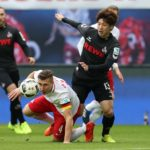 LEIPZIG, GERMANY - FEBRUARY 25: Willi Orban (L) of Leipzig vies with Yuya Osako (R) of Koeln during the Bundesliga match between RB Leipzig and 1. FC Koeln at Red Bull Arena on February 25, 2017 in Leipzig, Germany. (Photo by Ronny Hartmann/Bongarts/Getty Images)