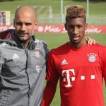 MUNICH, GERMANY - SEPTEMBER 10:  Team coach Josep Guardiola (L) and ew midfielder Kingsley Coman of FC Bayern Muenchen pose for photographers before a training session at the FC Bayern Muenchen training ground on September 10, 2015 in Munich, Germany.  (Photo by A. Beier/Getty Images for FC Bayern)
