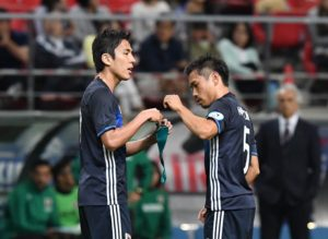 TOYOTA, JAPAN - JUNE 03:  Yuto Nagatomo #5 of Japan (R) received a band of captain by Makoto Hasebe #17 during the international friendly match between Japan and Bulgaria at the Toyota Stadium on June 3, 2016 in Toyota, Aichi, Japan.  (Photo by Masashi Hara/Getty Images)