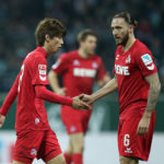 BREMEN, GERMANY - DECEMBER 17: Yuya Osako of Cologne shakes hands with Marco Hoeger of Cologne during the Bundesliga match between Werder Bremen and 1. FC Koeln at Weserstadion on December 17, 2016 in Bremen, Germany. (Photo by TF-Images/Getty Images)