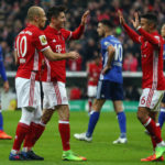 MUNICH, GERMANY - MARCH 01:  Robert Lewandowski (2L) of Muenchen celebrates his team's first goal with team mates Arjen Robben and Thiago Alcantara during the DFB Cup quarter final between Bayern Muenchen and FC Schalke 04 at Allianz Arena on March 1, 2017 in Munich, Germany.  (Photo by Lars Baron/Bongarts/Getty Images)