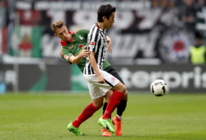 FRANKFURT AM MAIN, GERMANY - MARCH 05: Janik Haberer of Freiburg challenges Makoto Hasebe of Frankfurt during the Bundesliga match between Eintracht Frankfurt and SC Freiburg at Commerzbank-Arena on March 5, 2017 in Frankfurt am Main, Germany.  (Photo by Alex Grimm/Bongarts/Getty Images)