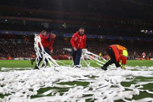 LONDON, ENGLAND - MARCH 07:  Streamers are removed from the pitch during the UEFA Champions League Round of 16 second leg match between Arsenal FC and FC Bayern Muenchen at Emirates Stadium on March 7, 2017 in London, United Kingdom.  (Photo by Clive Mason/Getty Images)