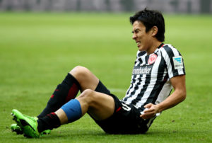 MUNICH, GERMANY - MARCH 11: Makoto Hasebe of Frankfurt sits injurd on the pitch during the Bundesliga match between Bayern Muenchen and Eintracht Frankfurt at Allianz Arena on March 11, 2017 in Munich, Germany.  (Photo by Alexander Hassenstein/Bongarts/Getty Images)