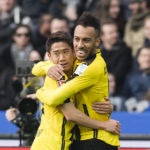 BERLIN, GERMANY - MARCH 11: Pierre-Emerick Aubameyang of Borussia Dortmund celebrates after scoring the goal to the 1:1 together with Shinji Kagawa during the Bundesliga match between Hertha BSC and Borussia Dortmund at the Olympiastadion on March 11, 2017 in Berlin, Germany.  (Photo by Alexandre Simoes/Borussia Dortmund/Getty Images)
