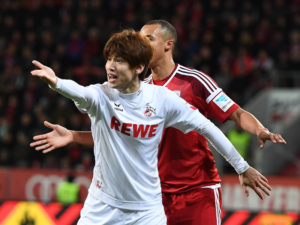 INGOLSTADT, GERMANY - MARCH 11: Yuya Osako (L) of 1. FC Koeln reacts next to Marcel Tisserand of FC Ingolstadt during the Bundesliga match between FC Ingolstadt 04 and 1. FC Koeln at Audi Sportpark on March 11, 2017 in Ingolstadt, Germany. (Photo by Lennart Preiss/Bongarts/Getty Images)
