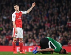 LONDON, ENGLAND - MARCH 11:  Granit Xhaka of Arsenal after his foul of Lincoln's Matt Rhead during the Emirates FA Cup Quarter-Final between Arsenal and Lincoln City at Emirates Stadium on March 11, 2017 in London, England.  (Photo by Stuart MacFarlane/Arsenal FC via Getty Images)