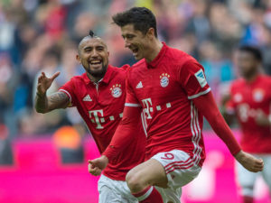 MUNICH, GERMANY - MARCH 11: Forward Robert Lewandowski (9) of Bayern Muenchen celebrating his goal  with Midfielder Arturo Vidal (23) of Bayern Muenchen during the 1. Bundesliga match between FC Bayern Muenchen and Eintracht Frankfurt at Allianz Arena on March 11, 2017 in Munich, Germany.  (Photo by Oliver Kremer at Pixolli Studios/Getty Images)