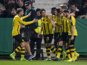 OSNABRUECK, GERMANY - MARCH 14: Christian Pulisic of Borussia Dortmund celebrates scoring the opening goal together with his team mates during the DFB Cup Quarter Final match between Sportfreunde Lotte and Borussia Dortmund at the Stadion an der Bremer Bruecke on March 14, 2017 in Osnabrueck, Germany.  (Photo by Alexandre Simoes/Borussia Dortmund/Getty Images)