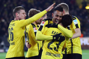 DORTMUND, GERMANY - MARCH 17:  Pierre-Emerick Aubameyang of Dortmund celebrates his team's first goal with team mates during the Bundesliga match between Borussia Dortmund and FC Ingolstadt 04 at Signal Iduna Park on March 17, 2017 in Dortmund, Germany.  (Photo by Lars Baron/Bongarts/Getty Images)