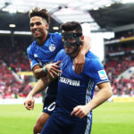 MAINZ, GERMANY - MARCH 19:  Sead Kolasinac of Schalke 04 is congratulated by Thilo Kehrer of Schalke 04 after scoring a goal during the Bundesliga match between 1. FSV Mainz 05 and FC Schalke 04 at Opel Arena on March 19, 2017 in Mainz, Germany.  (Photo by Alex Grimm/Bongarts/Getty Images)
