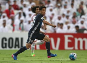 AL AIN CITY, UNITED ARAB EMIRATES - MARCH 23:  Shinji Kagawa of Japan in action during the FIFA 2018 World Cup qualifying match between United Arab Emirates and Japan at Hazza Bin Zayed Stadium on March 23, 2017 in Al Ain City, United Arab Emirates.  (Photo by Francois Nel/Getty Images,)