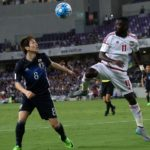 AL AIN, UNITED ARAB EMIRATES - MARCH 23: Genki Haraguchi (L) of Japan in action against Ahmed Barman (R) of United Arab Emirates during the 2018 FIFA World Cup Asian Qualifying group B football match between United Arab Emirates and Japan at the Hazza Bin Zayed Stadium in Al Ain, United Arab Emirates on March 23, 2017. (Photo by Mahmoud Khaled/Anadolu Agency/Getty Images)
