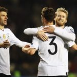 BAKU, AZERBAIJAN - MARCH 26:  André Schürrle of Germany celebrates scoring the fourth goal with Thomas Mueller and Jonas Hector during the FIFA 2018 World Cup Qualifiying group C  match between Azerbaijan and Germany at  on March 26, 2017 in Baku, Azerbaijan.  (Photo by Alexander Hassenstein/Bongarts/Getty Images)