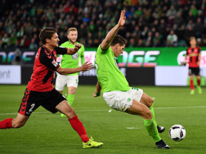 WOLFSBURG, GERMANY - APRIL 05:  Mario Gomez of Wolfsburg shoots during the Bundesliga match between VfL Wolfsburg and SC Freiburg at Volkswagen Arena on April 5, 2017 in Wolfsburg, Germany.  (Photo by Stuart Franklin/Bongarts/Getty Images)