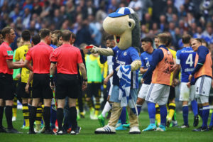 GELSENKIRCHEN, GERMANY - APRIL 01:  Referee, Felix Zwayer is shown a red card by the Schalke mascot, Erwin after the Bundesliga match between FC Schalke 04 and Borussia Dortmund at Veltins-Arena on April 1, 2017 in Gelsenkirchen, Germany.  (Photo by Dean Mouhtaropoulos/Bongarts/Getty Images)