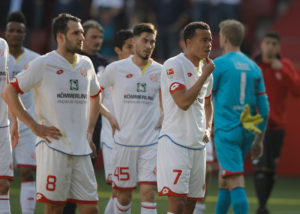INGOLSTADT, GERMANY - APRIL 02:  Levin Öztunali    and Robin Quaison of Mainz look dejected at the end of the Bundesliga match between FC Ingolstadt 04 and 1. FSV Mainz 05 at Audi Sportpark on April 2, 2017 in Ingolstadt, Germany.  (Photo by Adam Pretty/Bongarts/Getty Images)