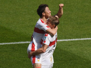 STUTTGART, GERMANY - APRIL 09:  Takuma Asano of Stuttgart celebrates his team's first goal with team mate Simon Terodde during the Second Bundesliga match between VfB Stuttgart and Karlsruher SC at Mercedes-Benz Arena on April 9, 2017 in Stuttgart, Germany.  (Photo by Matthias Hangst/Bongarts/Getty Images)