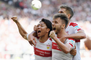 STUTTGART, GERMANY - APRIL 09:  Takuma Asano (L) of Stuttgart celebrates his team's second goal with team mates Alexandru Maxim (R) and Simon Terodde during the Second Bundesliga match between VfB Stuttgart and Karlsruher SC at Mercedes-Benz Arena on April 9, 2017 in Stuttgart, Germany.  (Photo by Matthias Hangst/Bongarts/Getty Images)
