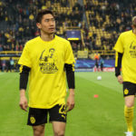 "DORTMUND, GERMANY - APRIL 12: Shinji Kagawa of Borussia Dortmund wears a T-shirt showing Marc Bartra and the words ""Mucha Fuerza"" which translates from Spanish into English of ""A lot of strength"" before the UEFA Champions League Quarter Final first leg match between Borussia Dortmund and AS Monaco at Signal Iduna Park on April 12, 2017 in Dortmund, Germany. (Photo by Matthew Ashton - AMA/Getty Images)"