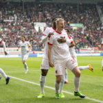 AUGSBURG, GERMANY - APRIL 15: Martin Hinteregger of FC Augsburg celebrate with team mates after he scores the first goal during the Bundesliga match between FC Augsburg and 1. FC Koeln at WWK Arena on April 15, 2017 in Augsburg, Germany. (Photo by Jan Hetfleisch/Bongarts/Getty Images)