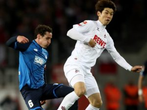 COLOGNE, GERMANY - APRIL 21: Yuya Osako (R) of Koeln and Sebastian Rudy of Hoffenheim battle for the ball during the Bundesliga match between 1. FC Koeln and TSG 1899 Hoffenheim at RheinEnergieStadion on April 21, 2017 in Cologne, Germany.  (Photo by Lars Baron/Bongarts/Getty Images)