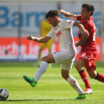 LEVERKUSEN, GERMANY - MAY 13:  Charles Aranguiz of Bayer 04 Leverkusen battles for the ball with Milos Jojic of Koeln during the Bundesliga match between Bayer 04 Leverkusen and 1. FC Koeln at BayArena on May 13, 2017 in Leverkusen, Germany.  (Photo by Dean Mouhtaropoulos/Bongarts/Getty Images)
