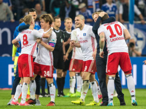GELSENKIRCHEN, GERMANY - MAY 13: Players of Hamburg celebrate after the Bundesliga match between FC Schalke 04 and Hamburger SV at Veltins-Arena on May 13, 2017 in Gelsenkirchen, Germany. (Photo by Lukas Schulze/Bongarts/Getty Images)