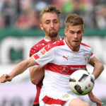 HANOVER, GERMANY - MAY 14:  Florian Hbner of Hannover is challenged by Simon Terodde of Stuttgart during the Second Bundesliga match between Hannover 96 and VfB Stuttgart at HDI-Arena on May 14, 2017 in Hanover, Germany.  (Photo by Stuart Franklin/Bongarts/Getty Images)