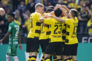 DORTMUND, GERMANY - MAY 20: Pierre-Emerick Aubameyang of Borussia Dortmund celebrates after scoring the goal to the 2:1 with his team mates during the Bundesliga match between Borussia Dortmund and Werder Bremen at Signal Iduna Park on May 20, 2017 in Dortmund, Germany.  (Photo by Alexandre Simoes/Borussia Dortmund/Getty Images)