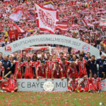 MUNICH, GERMANY - MAY 20:  Bayern Muenchen players and staff pose with the Championship trophy in celebration of the 67th German Championship title following the Bundesliga match between Bayern Muenchen and SC Freiburg at Allianz Arena on May 20, 2017 in Munich, Germany.  (Photo by Matthias Hangst/Bongarts/Getty Images)